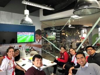 IdentityX Ambassador Luisa Torres and her internship colleagues watching the World Cup in Lima, Peru.