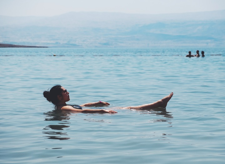 An Jimenez floating and relaxing in the Dead Sea.